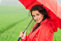 Smiling woman looking at camera during rainfall Royalty Free Stock Photography