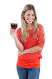 Smiling woman looking at the camera with red wine glass Royalty Free Stock Image