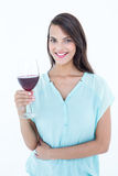 Smiling woman looking at the camera with red wine glass Royalty Free Stock Photo