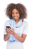 Smiling woman looking at camera and typing a text message Stock Images