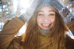 Smiling woman looking at camera in winter park Royalty Free Stock Photos