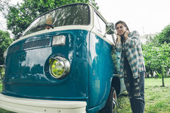 Smiling woman looking in camper van window Stock Photos