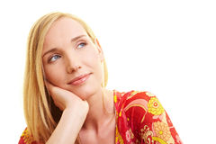 Smiling woman looking dreamy Stock Image