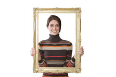 Smiling woman looking through empty frame Royalty Free Stock Photos