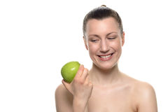 Smiling Woman Looking at Green Apple on her Hand Royalty Free Stock Photo