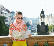 Smiling woman looking at map near National Museum in Prague Stock Image