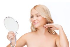 Smiling woman looking at mirror Stock Photos