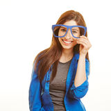 Smiling woman looking through nerd Royalty Free Stock Photo