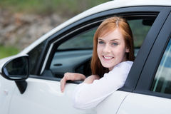 Smiling woman looking out of a car window Royalty Free Stock Photo