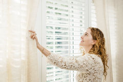 Free Smiling Woman Looking Out Window Royalty Free Stock Photography - 29428997