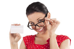 Smiling woman looking and showing card Royalty Free Stock Images