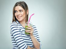 Smiling woman looking side holding green cocktail Stock Image