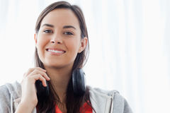 A smiling woman looking slightly down into the camera Stock Photos