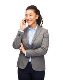 Smiling woman looking at smartphone Royalty Free Stock Photo