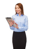 Smiling woman looking at tablet pc Stock Image