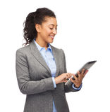 Smiling woman looking at tablet pc Royalty Free Stock Images