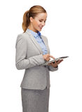 Smiling woman looking at tablet pc computer Stock Photos
