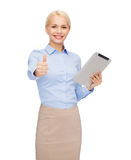 Smiling woman looking at tablet pc computer Stock Image