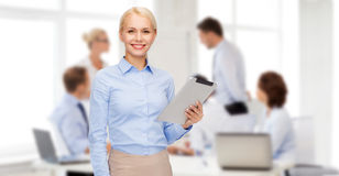 Smiling woman looking at tablet pc computer Royalty Free Stock Images
