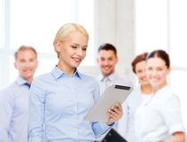 Smiling woman looking at tablet pc computer Stock Images