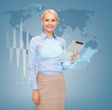 Smiling woman looking at tablet pc computer Royalty Free Stock Image