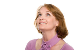 Smiling woman looking up Stock Images