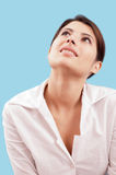 Smiling woman looking up Royalty Free Stock Images
