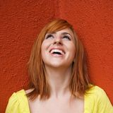 Smiling woman looking up Royalty Free Stock Photos
