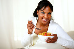 Smiling woman looking at you having breakfast Stock Photos