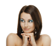 Smiling woman looks askance Royalty Free Stock Photography