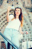 Smiling woman with luggage doing selfie. At vacation Royalty Free Stock Photography