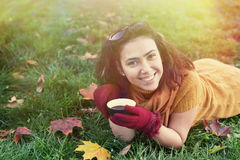 Smiling woman lying on autumn leaves Royalty Free Stock Photo