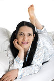 Smiling woman lying  on bed Royalty Free Stock Images