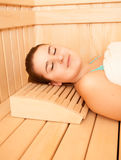 Smiling woman lying on bench at sauna Royalty Free Stock Image