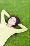 Smiling woman lying on the grassland Royalty Free Stock Photo
