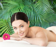 Smiling woman lying on the massage desk Royalty Free Stock Photos