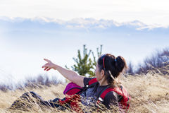Smiling woman lying on a meadow  in a high mountain Stock Image