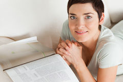 Smiling woman with a magazine Stock Image