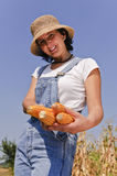 Smiling woman with maize Royalty Free Stock Images