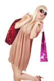 Smiling woman makes shopping Royalty Free Stock Photography