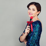 Smiling Woman Makeup Artist with Red Makeup Brush Royalty Free Stock Photography