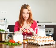 Smiling woman  making dough in  kitchen Royalty Free Stock Photo