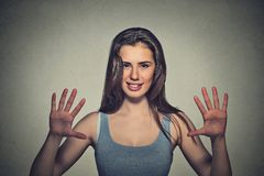 Smiling woman making five times sign gesture with hands fingers Stock Photos