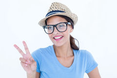 Smiling woman making peace and love gesture Royalty Free Stock Photos