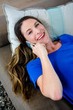 Smiling woman making a phone call on her mobile Stock Image