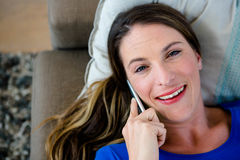 Smiling woman making a phone call on her mobile Stock Photography