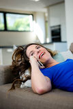 Smiling woman making a phone call on her mobile Royalty Free Stock Photo
