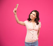 Smiling woman making selfie photo on smartphone Stock Images