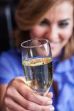 Smiling woman making a toast Stock Photography