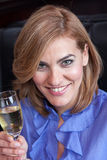 Smiling woman making a toast Royalty Free Stock Photography